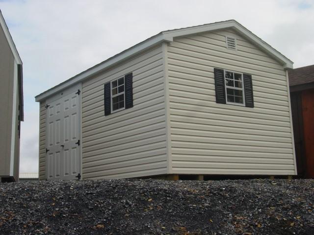 (Building #009) 10×16 Vinyl Cottage