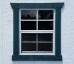 Wood window trim on painted building