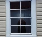 Coil window trim on Vinyl building